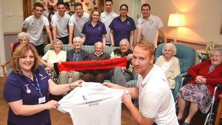 Ely City FC have had their training tops sponsored by The Grange, Littleport, some of the resdients