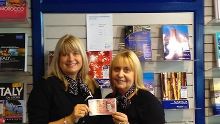 Branch manager Sue Steel with senior travel consultant Kerry Crisp and their £50 float from Arthur R