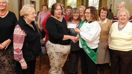 Jan Avenell treasurer of Chatteris Morning WI presenting cheque to Gill Smith Chair of March Chatter