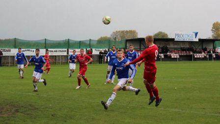 Wisbech Town in action against Rothwell Corinthians