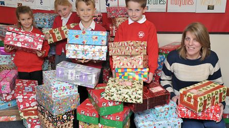 Shoe Box collection at St Andrews CofE Primary School. Soham. Left: Pupils Eve, Amelia, Guy and Rive