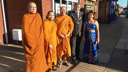 Buddhist monks bless a new Thai restaurant in March