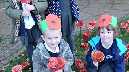 Remembrance Day at Westwood Primary School, March. Year 2 pupils with some of the poppies.Picture: S
