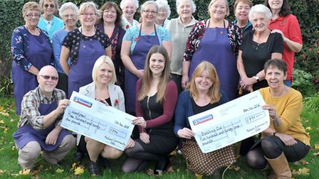 Cheque presentation by Nellie's Community Café to charity of money raised over the last six months.