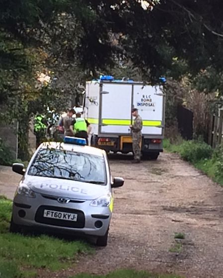 Bomb squad at the home of Christine Battersby where a hand grenade was found inside an old apple tre
