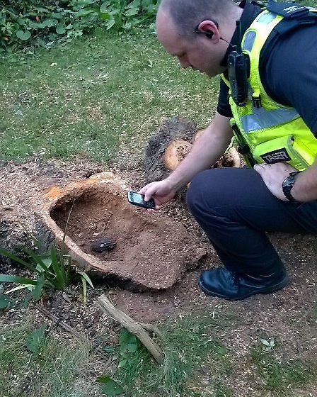 Further image from Back Hill, Ely. PC Williams photographing for EOD purposes prior to sandbagging