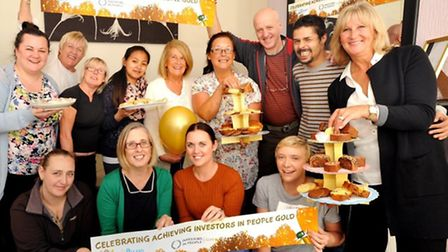 CEO Sandie Foxall-Smith (standing right) with staff at one of the celebratory tea parties at Oakland