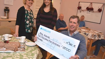 Fen House Ely receive a cheque from ex-service user Terry Wilby, for £2500, with (l-r) Roxanne Rolan