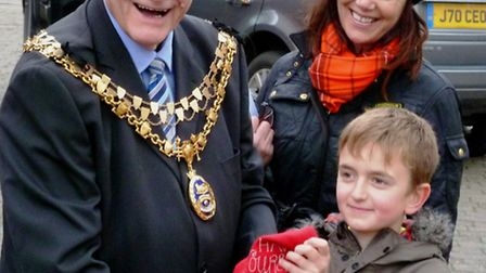 Elliott Hurrell receiving his prize from the Mayor of Tiverton.