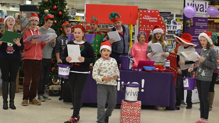 Members of Aviva Community and Arts Group who volunteered at Tesco in Ely to raise funds for their p