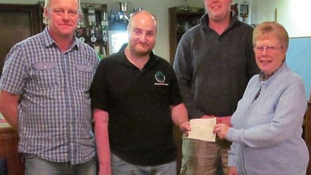 Magpas volunteer Mark Klingo (second left) receiving the cheque with Rita Mace, sister of the late P