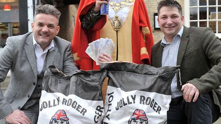 £2,000 raised by the great potato sack race earlier this autumn. Left: Austin Dack, Mayor of Ely Liz