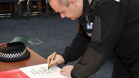 Anti Loan Shark agreement being signed at Fenland Hall. Mark Plitsch Cambs police.