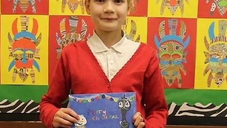 Cleo Bailey, 10, with her winning Christmas card design