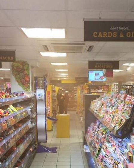 A smoke bomb is thrown into the Whittlesey Nisa. None of the people in the images are involved in th