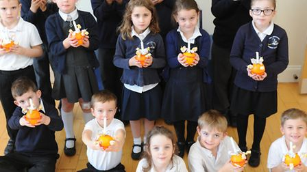 Pupils at Mepal and Witcham Christingle Service