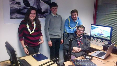 Ely scouts' Greg Pollard (second left) joined other scouts from Cambridgeshire to broadcast their ow
