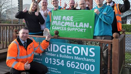 Charity fund raising by Ridgeons staff. March Store. £482 raised for Macmillan cancer support. Pict
