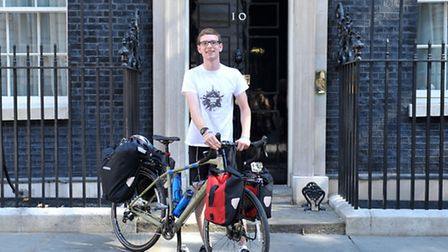 Callum Fairhurst outside number 10 Downing street.His latest cycling challenge from the gates of Dow