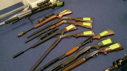 A collection of rifles that was discovered at a property in Soham this morning.
