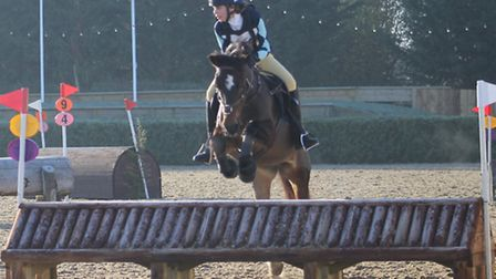 King's Ely's Rebecca Everitt on her horse, Rita, at the College Keysoe Arena in Bedfordshire on Nove