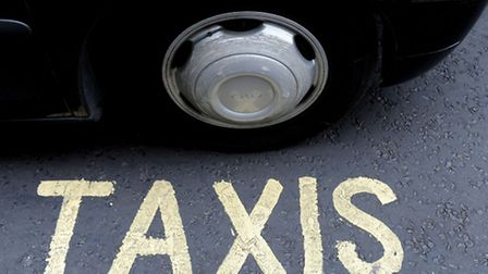 File photo dated 28/07/14 of a London taxi passing by a taxis sign on the road. London cabbies are s