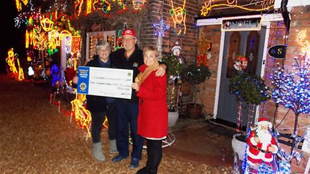 Cheque presentation from Whittlesey Lions to John and Gina Ferridge for their Christmas lights fund