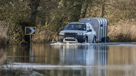 The A1101 road at Welney is currently under water and closed for access. Picture: Matthew Usher.