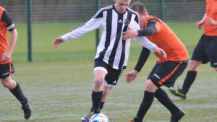 Action from the NMC 4B clash betweenWitchford 96 Reserves and Isleham United (stripes)