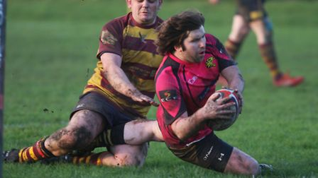 Ely Tigers' Daniel Coulson touches down for a try. Pictures: Steve Wells