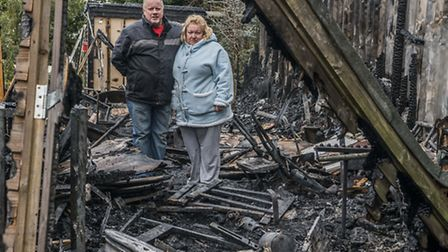 Edward and Berenice Francis with their home in Southery, which has been gutted by fire on New Years