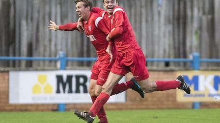Ely City's Craig Neal (left) celebrates scoring his superb first-half goal against . Picture: Matthe