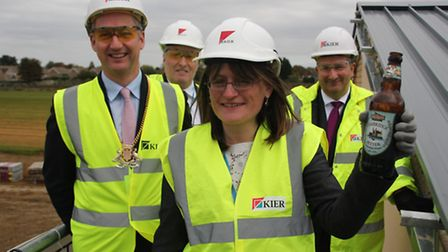 Isle of Ely topping out, from left; Sebastian Kindersley, chairman Cambridgeshire County Council; Ga