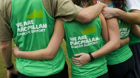 Runners unite before taking part in a charity run for Macmillan Cancer