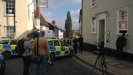 Reporters and camera crews gather at the crime scene in Dunmow