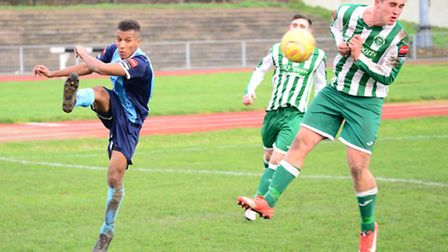 Ryan Sharman attempts to close the ball down for Soham Town Rangers.
