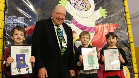 Thomas Reed (left), Cameron Webb and Megan Cooke with Cllr Peter Murphy in the Manor Centre's soft p