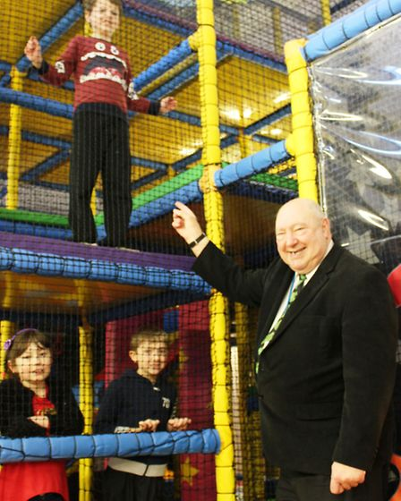 Cllr Peter Murphy with Thomas Reed (top), Megan Cooke and Cameron Webb in the Manor Centre's play ar