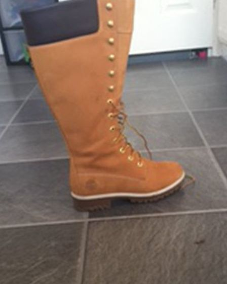 Sherry Smith's light brown knee-high Timberland boots