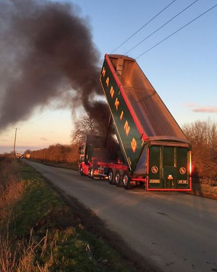 Incident at Block Fen Mepal where a lorry driver was injured after his Hankins Ltd vehicle hit overh