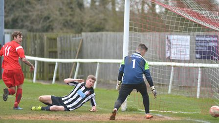 Craig Neal notches Ely City's third against Dereham Town Reserves in the Robins' 3-2 victory.