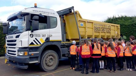 Robert Arkenstall Primary School students receive a road safety demonstration by Mick George.