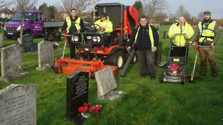 Councillor Peter Murphy (second right) joins ISS staff as grass-cutting gets under way in Eastwood C