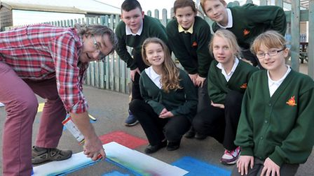 Artist Terry Martin with year 6 Pupils from Orchard primary school Wisbech, Terry is creating a gian
