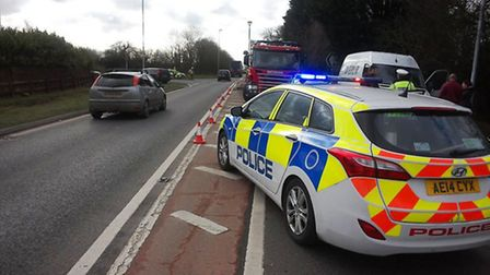 Police at scene of collision on Isle of Ely Way, Wimblington near March, Cambs