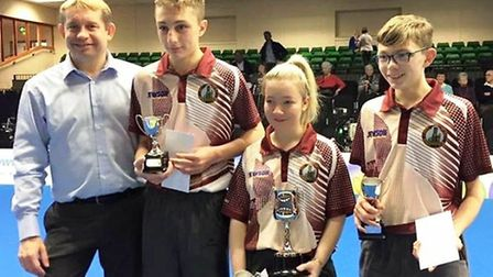 2010 World Indoor Bowls singles champion, Greg Harlow with Ely Juniors Ben Chapman, Lucy Akroyd and
