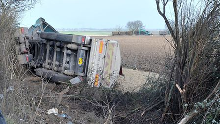 Geoff Hobbs lorry leaves road, ends up overturned in a farm on A142, New Road junction, Chatteris. P