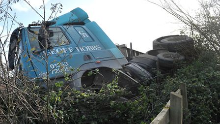 Geoff Hobbs lorry leaves road, ends up overturned in a farm on A142, New Road junction, Chatteris Pi