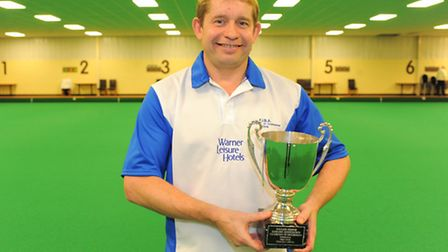 Greg Harlow proudly shows off his Champion of Champions trophy.