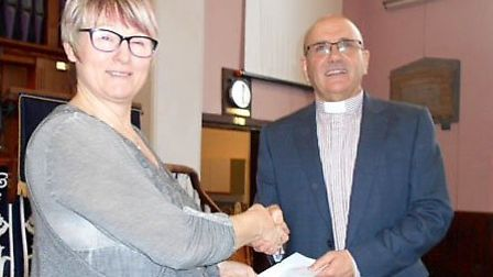 Soham Methodist Church. Pauline receiving the cheque from our Minister Rev Colin Watkins.